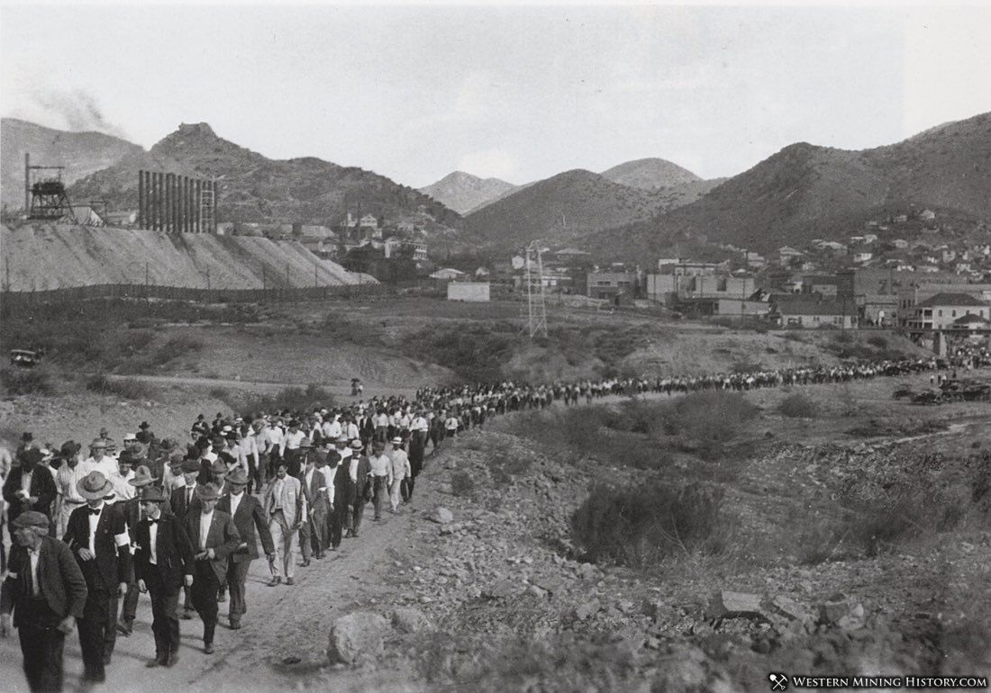2000 striking miners being escorted out of Bisbee under guard of posse members with white arm bands.