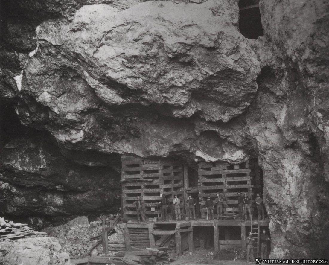 Miners pose on timbering at the Copper Queen Mine