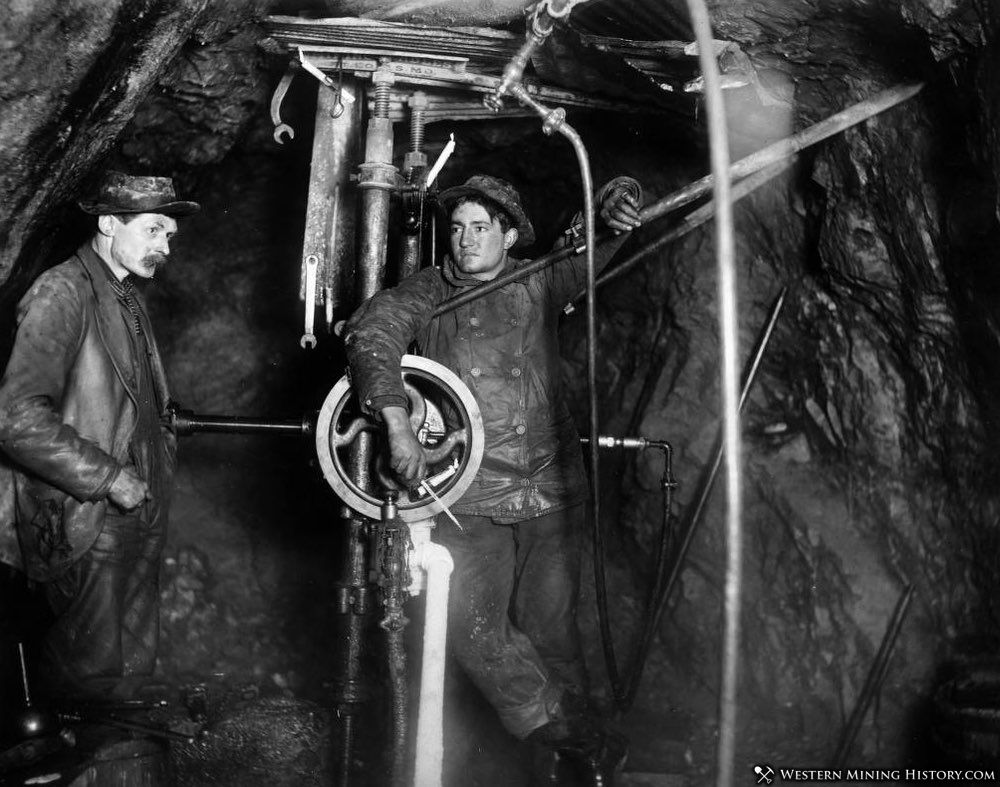 Miners with a pneumatic drill at the Camp Bird mine ca. 1900