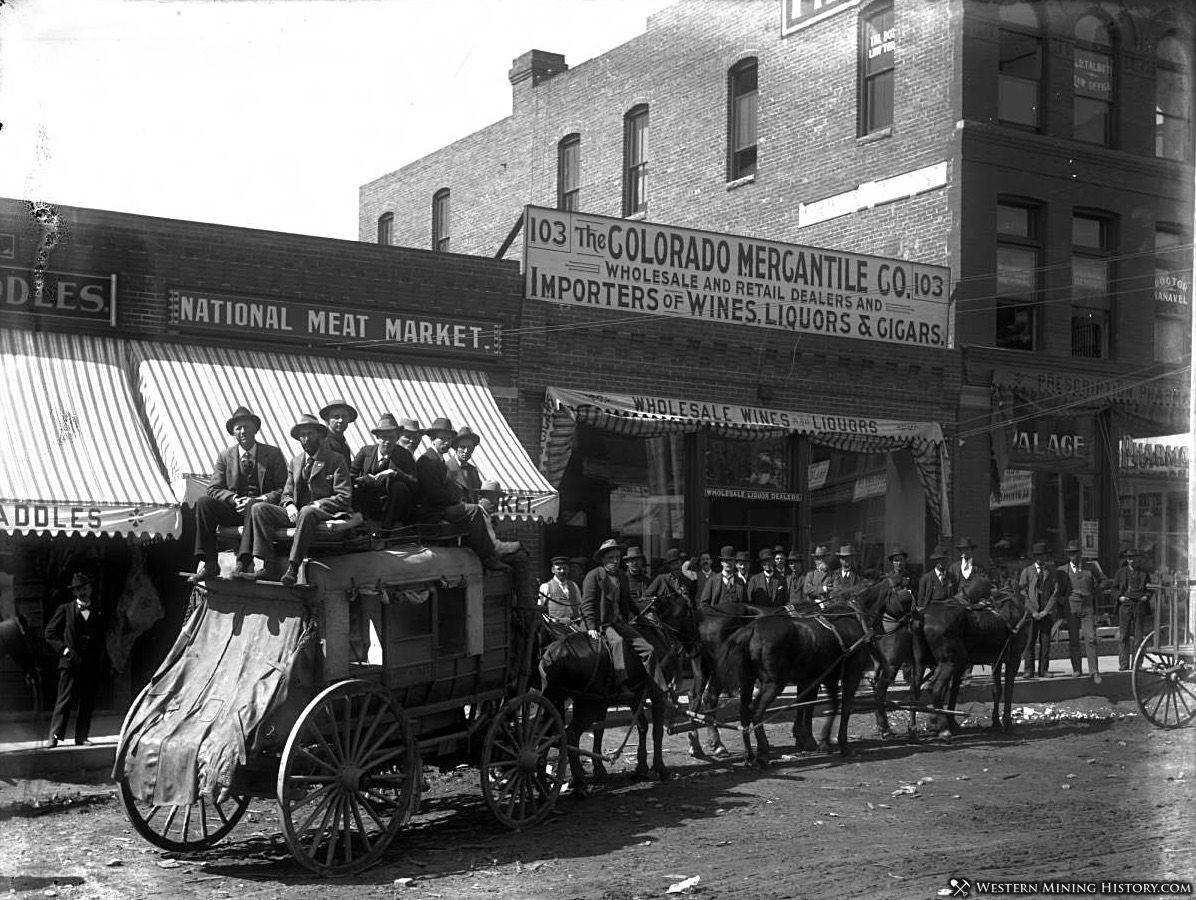A stagecoach is loaded with passengers at Cripple Creek Colorado ca. 1896