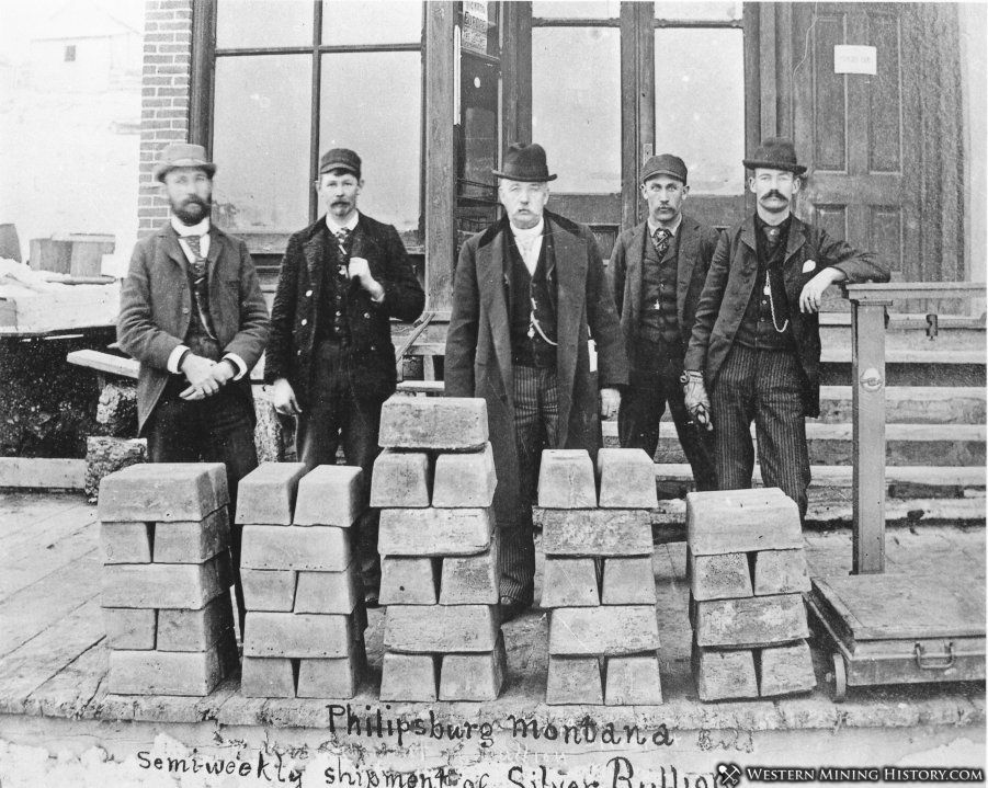 Executives of the Granite Mountain mine pose in Philpsburg with a shipment of silver bars