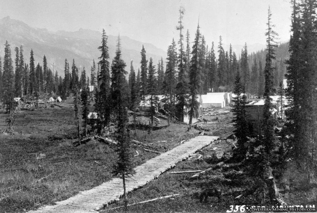 This photo appears to show Red Mountain Town at it's initial location on marshland. Note the log road across the soft ground