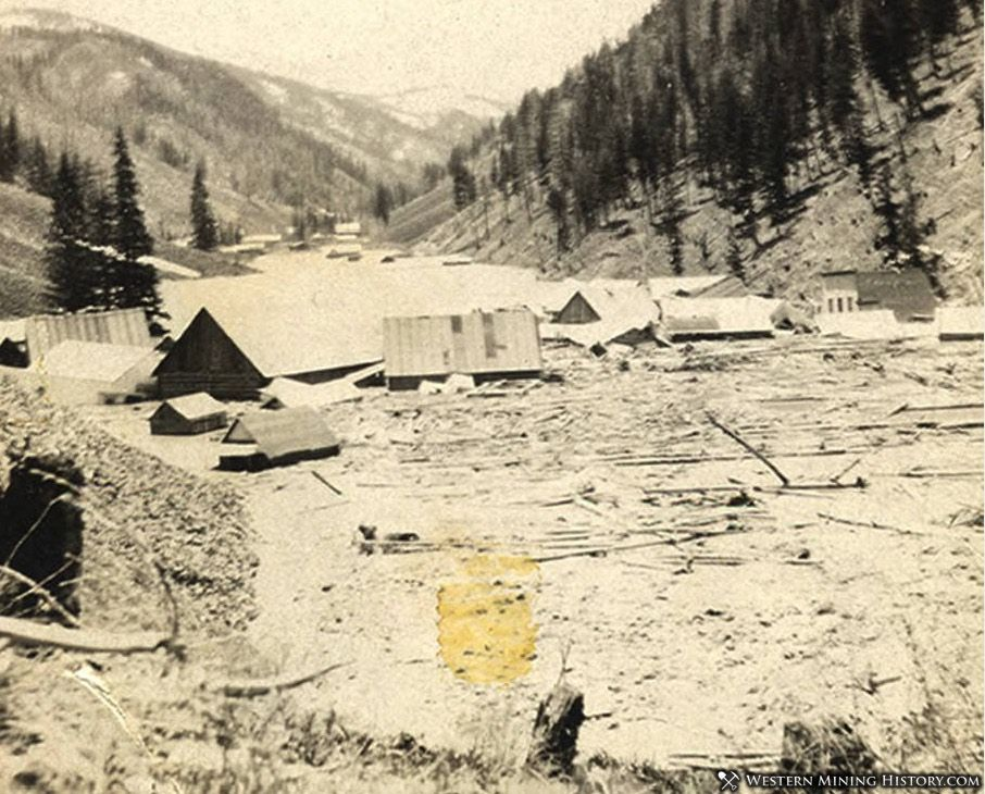 Rising waters of Monumental Creek slowly submerging Roosevelt, Idaho 1909