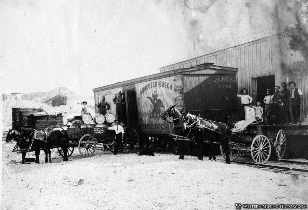 """Anheuser-Busch """"Beer Car"""" boxcar and horse teams and wagons at Tonapah depot ca 1910"""