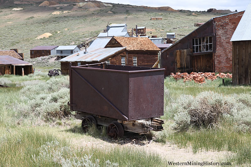 Ore car and buildings at Bodie