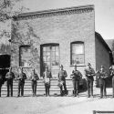 Oro Fino Band in front of a public building in Oro Fino, California ca 1889