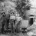 Miners and ore cart at unidentified mine near Oro Fino, California ca 1900