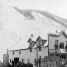Horse-drawn sleighs stacked with bales of hay  - Telluride Colorado 1892