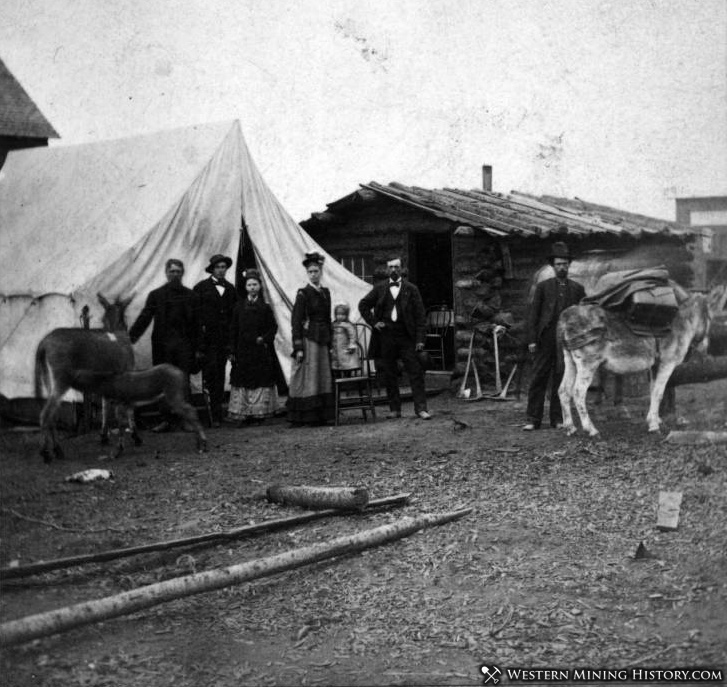 Family poses outside their tent home in Leadville, Colorado in 1879