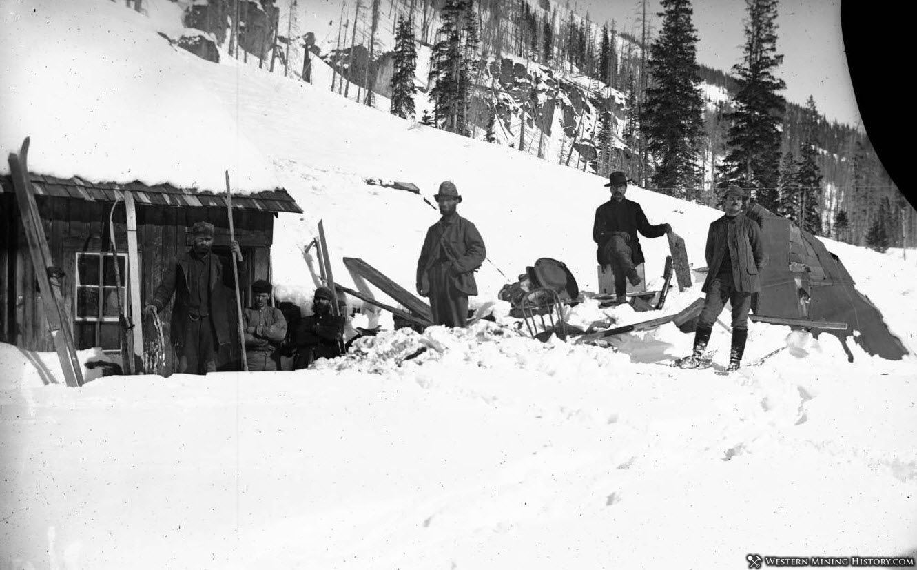 Men on skis survey avalanche damage - Sneffels Colorado