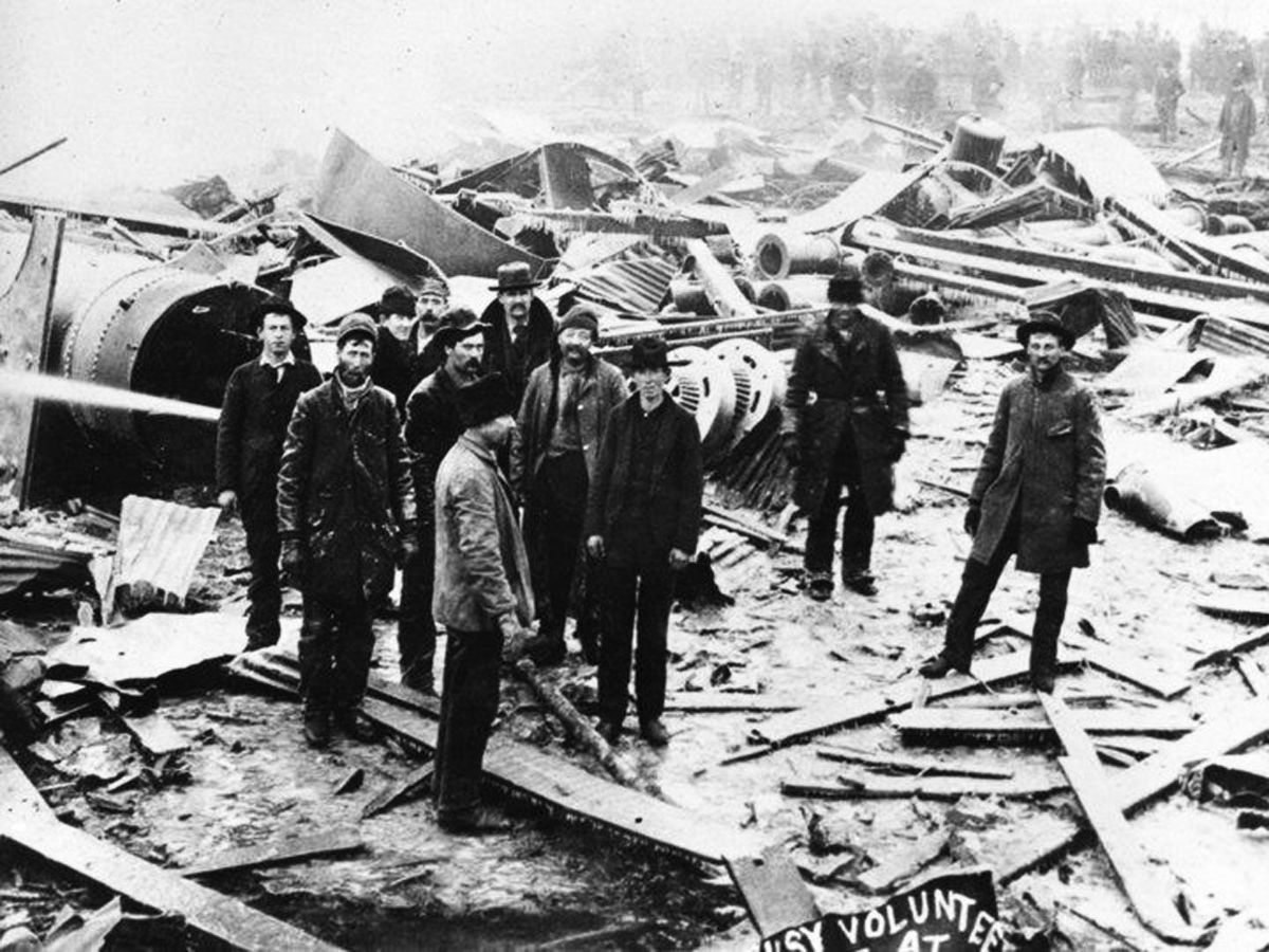 Volunteers help sort through the devastation of the 1895 explosion in Butte, Montana