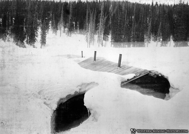 Miners cabin is buried in snow somewhere in Colorado ca. 1890