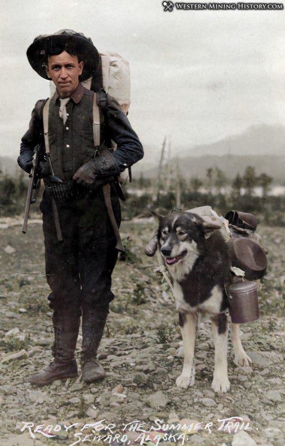 Prospector with his dog near Seward, Alaska 1900-1916